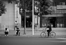 Two men, a woman and a bike