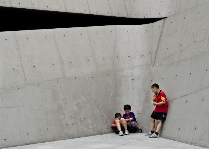 Three boys in a corner